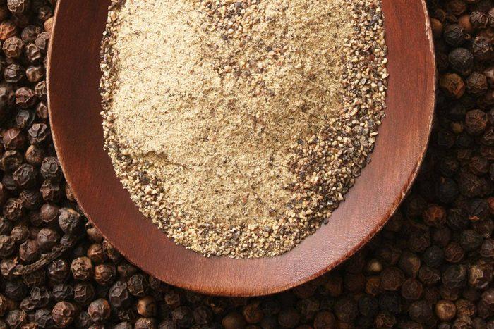 bowl of ground black pepper