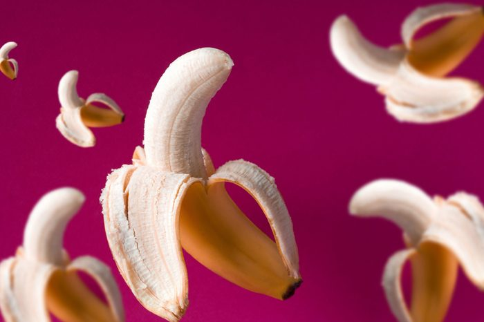 fresh flying bananas pattern on a vibrant pink background