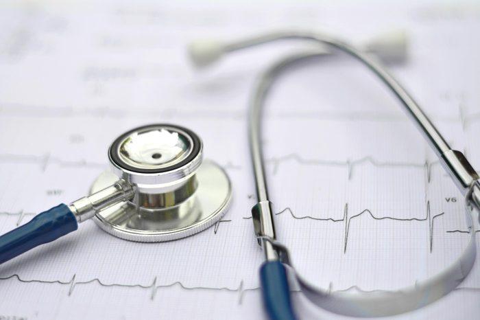 stethoscope on a cardiac readout
