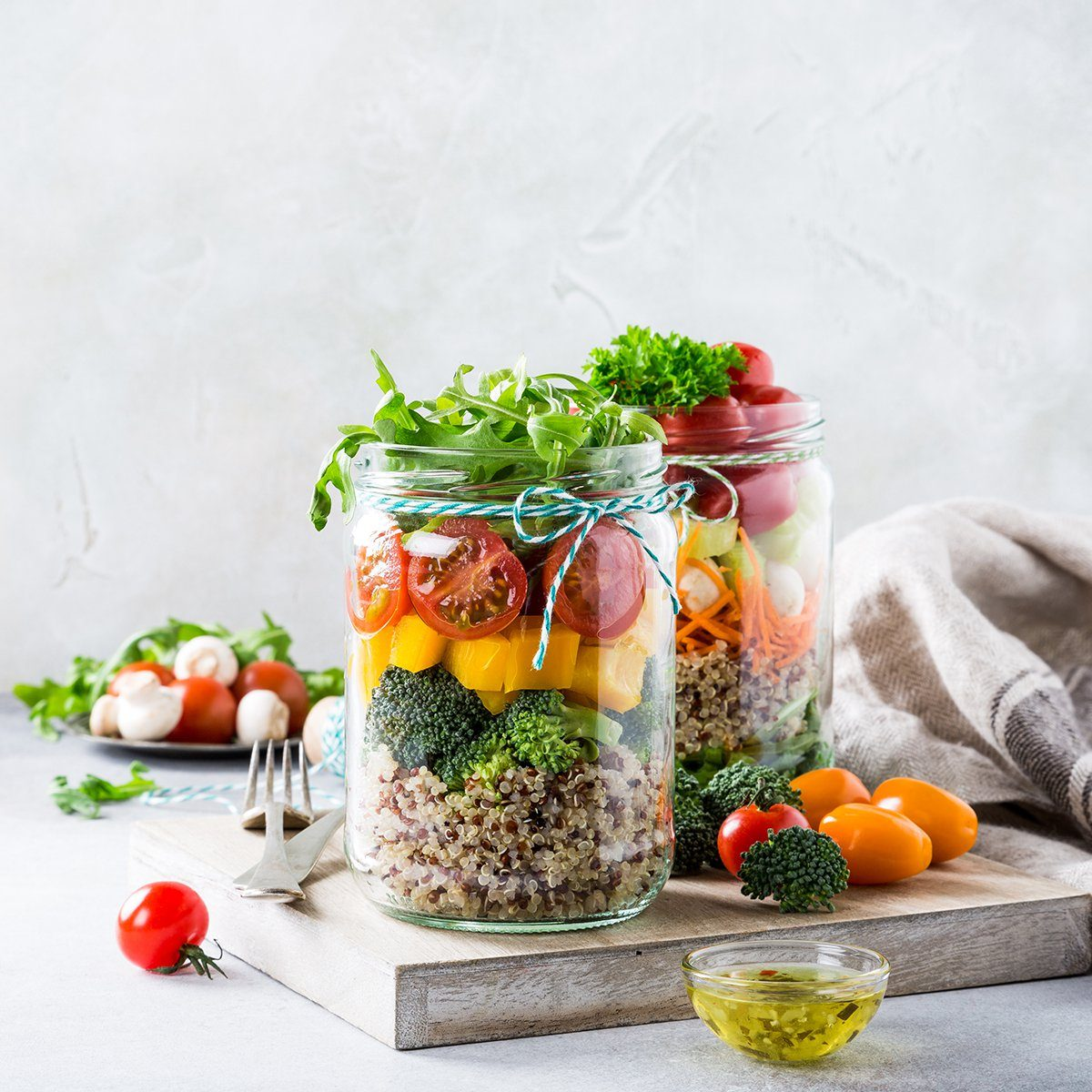 Homemade salad in glass jar with quinoa and vegetables.