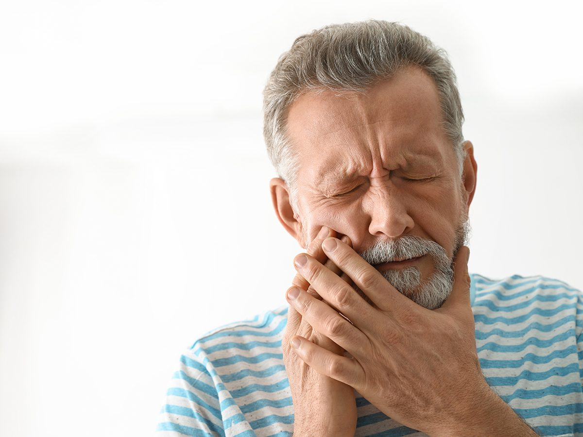 Man suffering from tooth pain