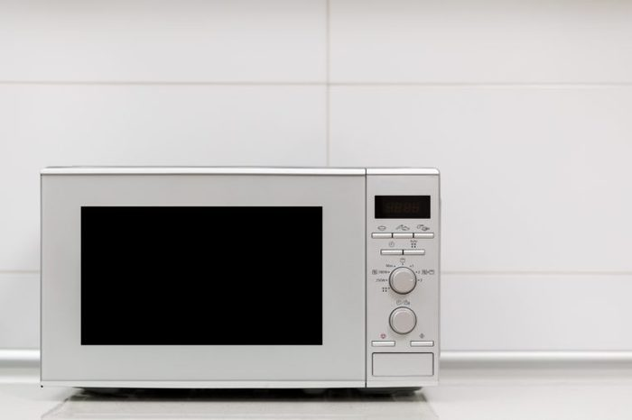 Modern kitchen interior. Kitchen interior with gas stove and microwave oven close up