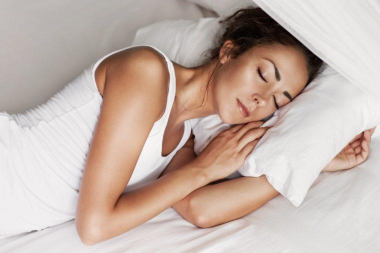 Woman sleeping on her side