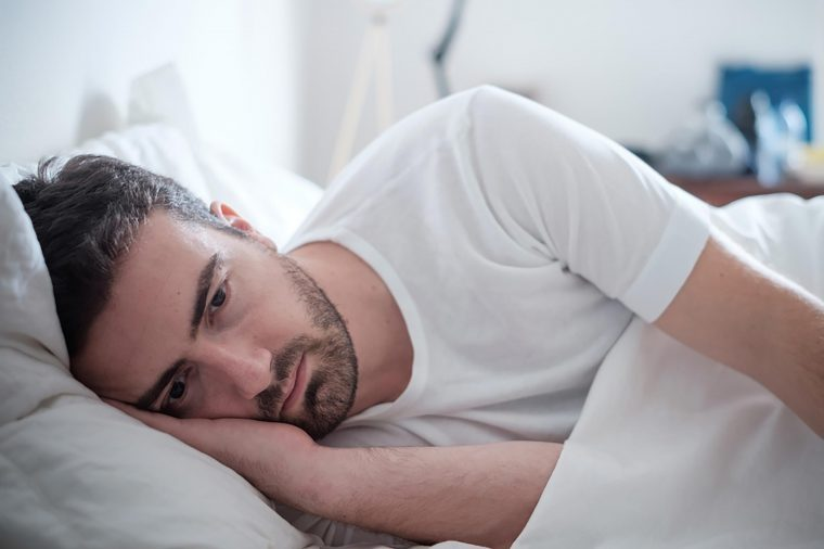 Man lying in bed on his side