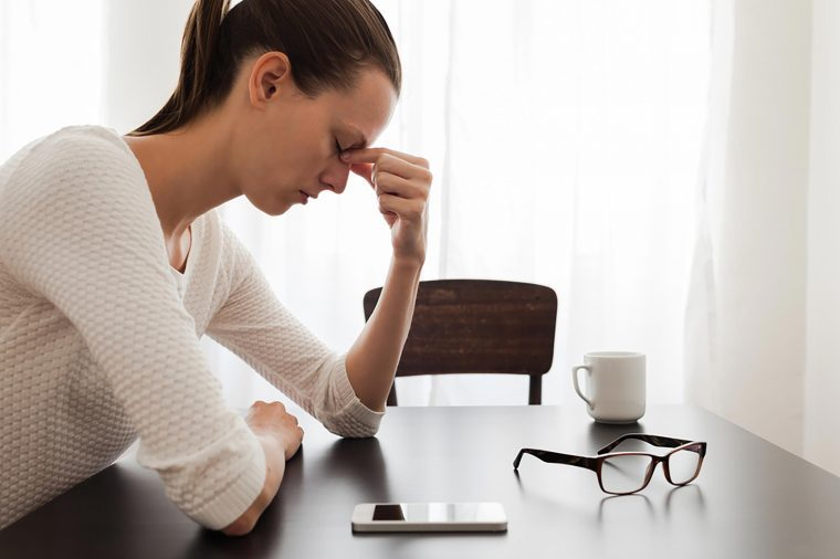 Stressed woman sitting at table