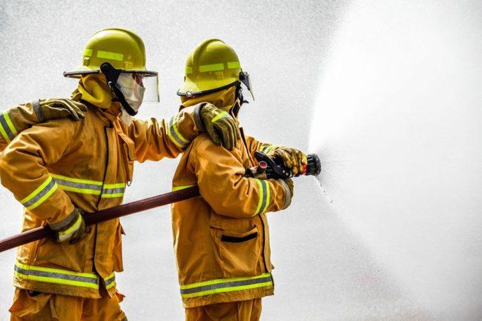 Fireman firemen hose putting out fire