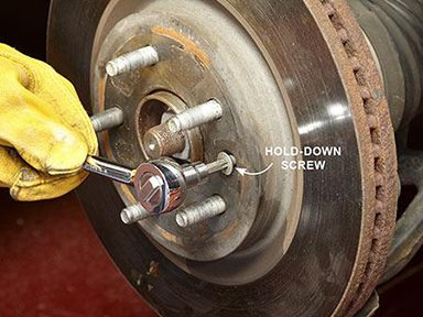 Remove the rotor hold-down