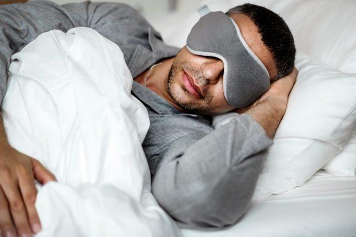 man sleeping bed eye sleep mask