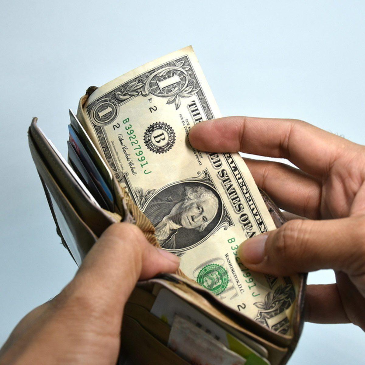 shutterstock_546271135 saving money wallet with dollars save money