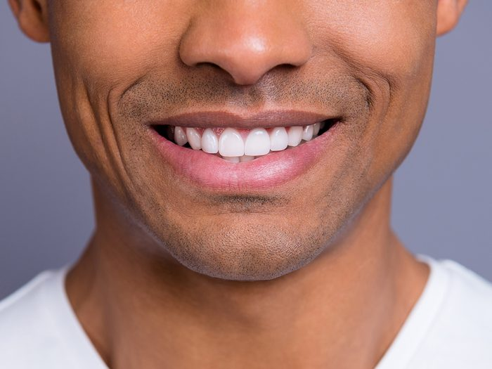 Signs of disease your teeth can reveal - man smiling with nice teeth