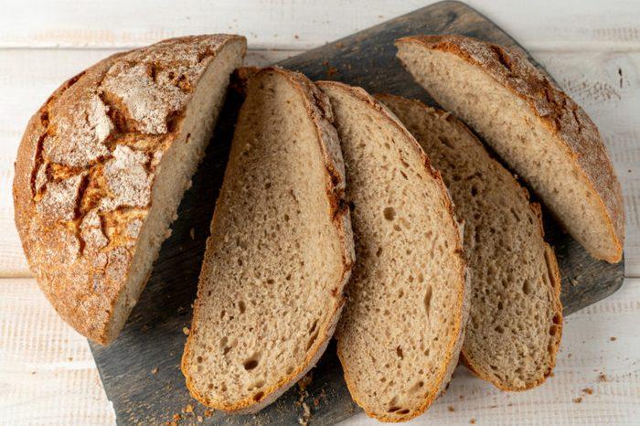 sliced rye bread on cutting board close up