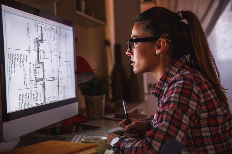 Woman staring at computer monitor