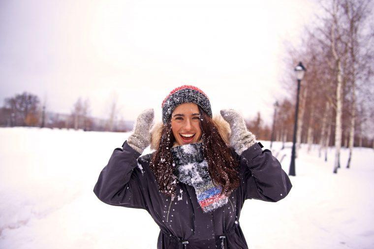 Woman having fun in the snow