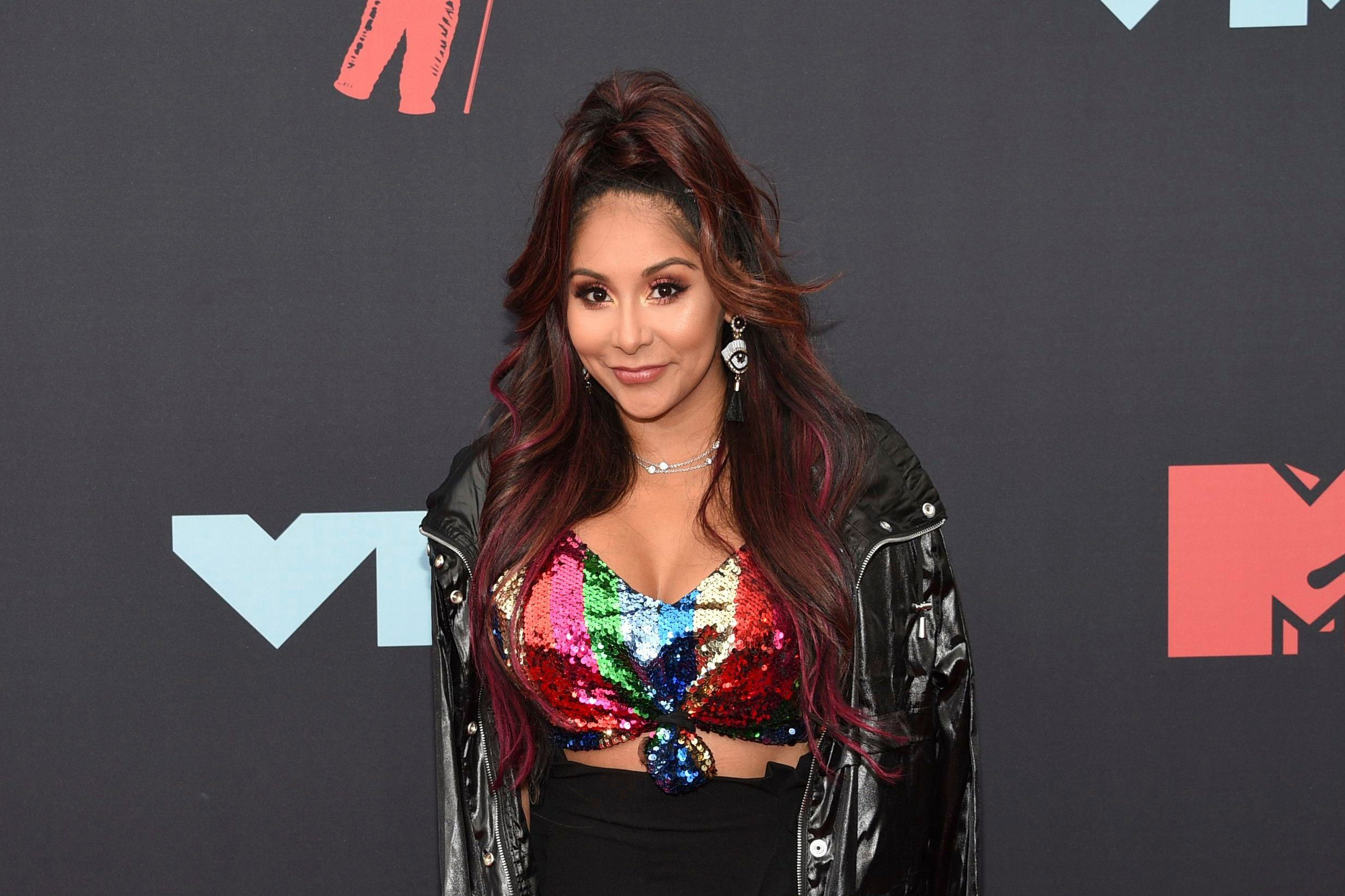 """Mandatory Credit: Photo by Evan Agostini/Invision/AP/Shutterstock (10372528cc) Nicole Snooki Polizzi. Nicole """" Nicole Snooki Polizzi """" Polizzi arrives at the MTV Video Music Awards at the Prudential Center, in Newark, N.J 2019 MTV Video Music Awards - Arrivals, Newark, USA - 26 Aug 2019"""