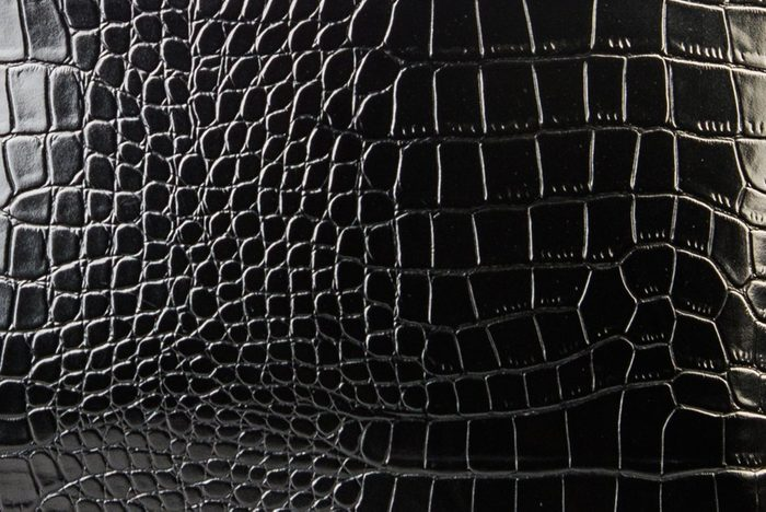 The texture of the leather in black. Patent leather