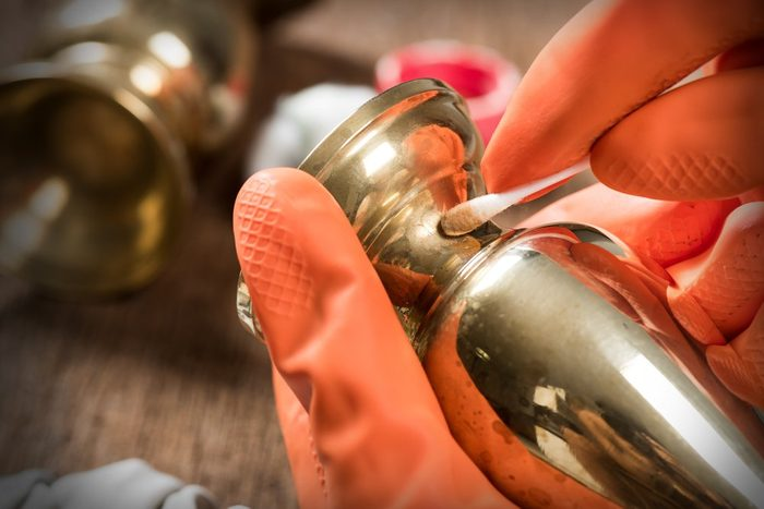 cleaning and polishing old brass jar