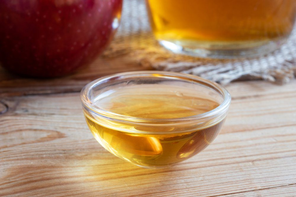 A bowl of apple cider vinegar