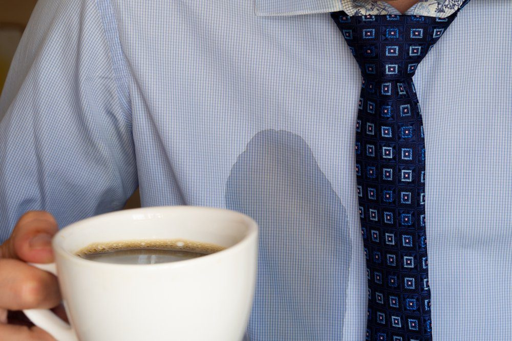 The man spilled his coffee on himself.
