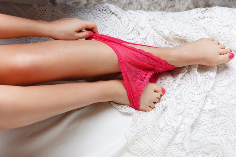 Woman taking off her panties