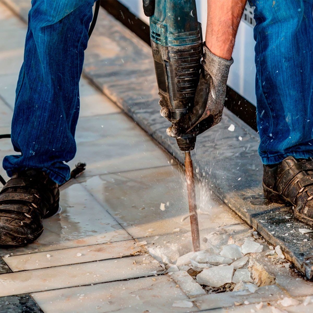 jackhammer removing crushing tile