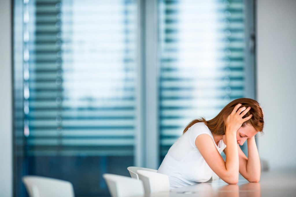 Stressed woman in boardroom