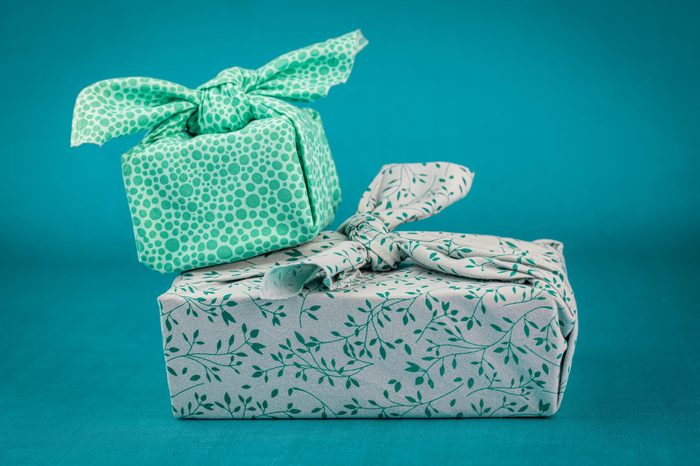 Fabric wrapped gifts, reusable sustainable recycled textile gift wrapping alternative zero waste concept