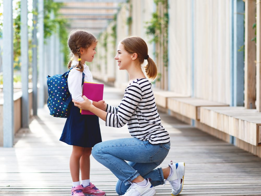 Mom and child outside school