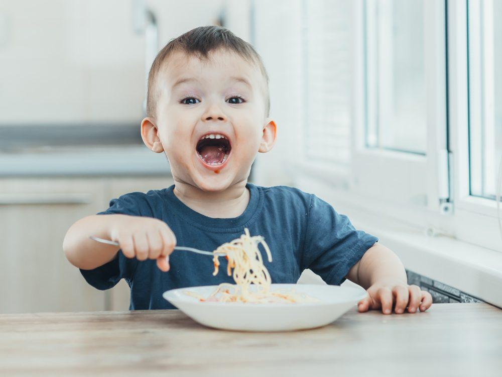 Kid eating pasta