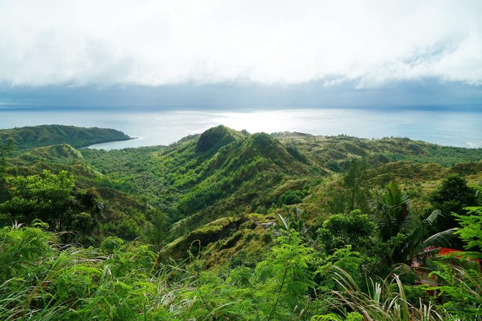 An observation deck with a very old jungle forest and blue sea. Cetti Bay, Guam