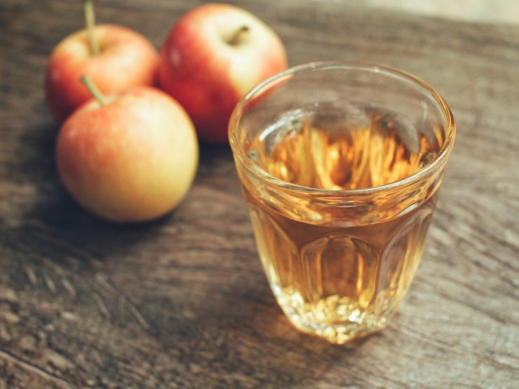 Apple cider vinegar in transparent cup