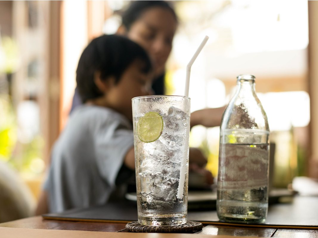 Iced water drink with slice of lemon