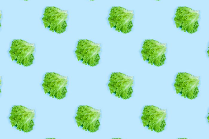 Pattern of fresh Green lettuce on blue background. Top view. Summer concept. Collage