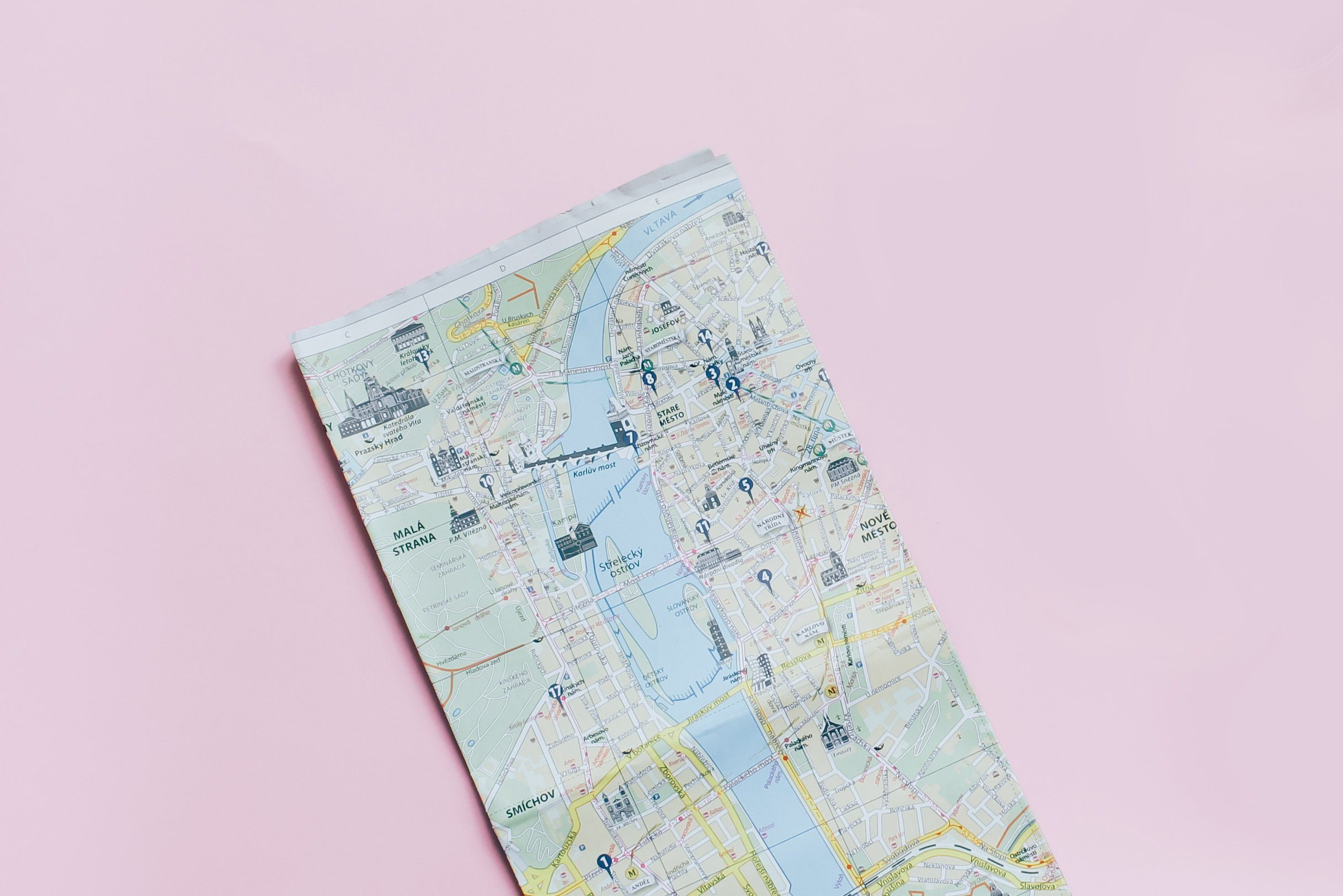Travel planning concept : map, smartphone, sunglasses and hot coffee cup on pink background, top view with minimal style; Shutterstock ID 524232931; Job (TFH, TOH, RD, BNB, CWM, CM): RD