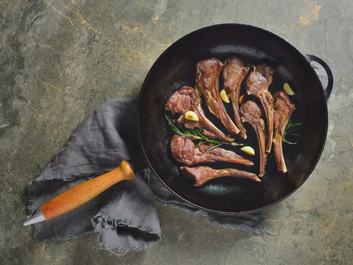 Roasted lamb chops in a cast-iron pan