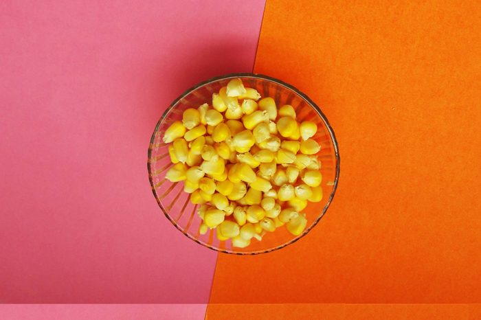 healthy raw sweet corn isolated on color background