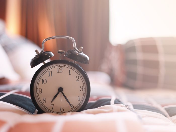 Daylight saving time - vintage clock on bed
