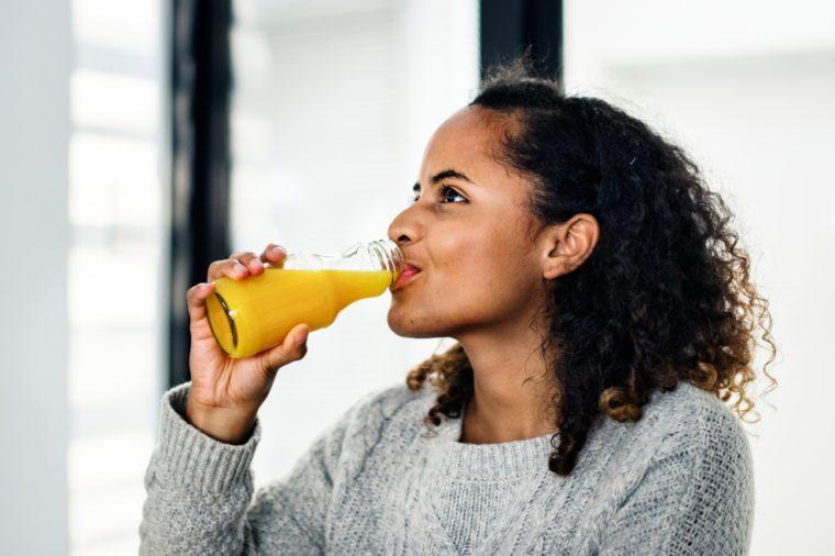 Attractive woman drinking orange juice