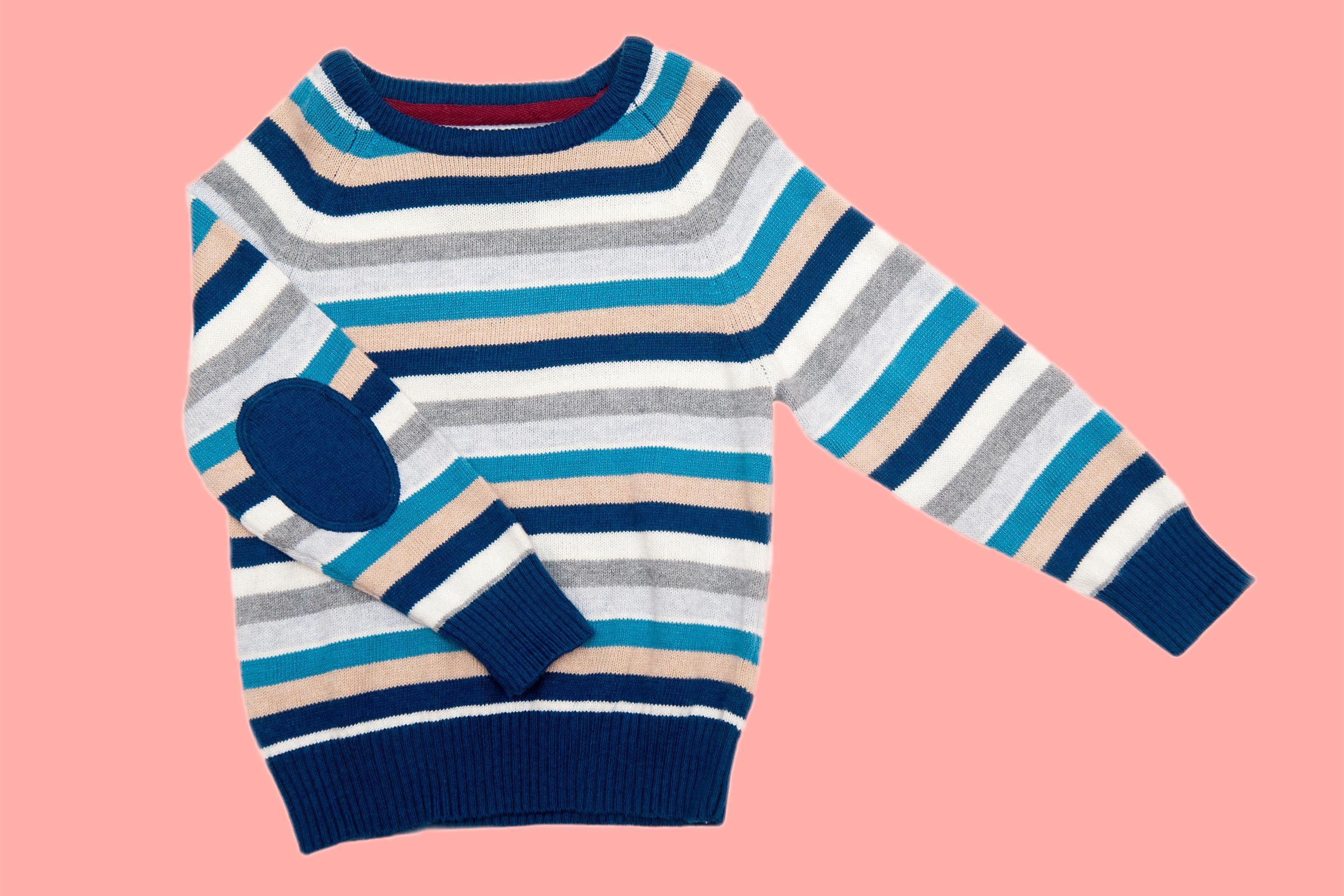 Children warm sweater on a white isolated background elbow patch