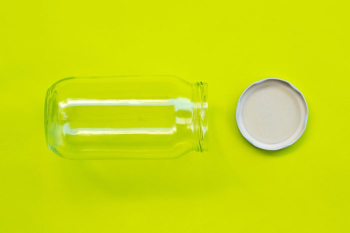 lid for jars and jar on green background