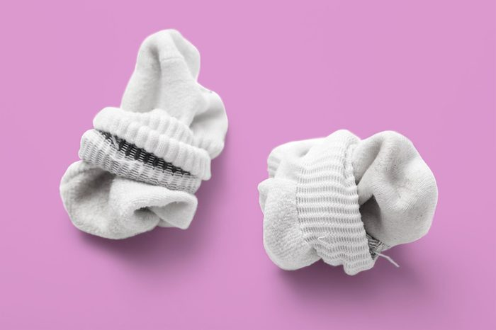 used sock isolated on a white background balled up