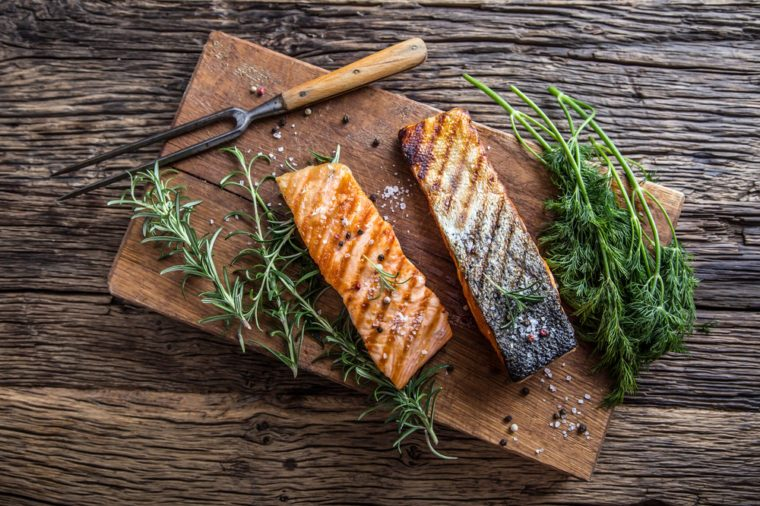 Two grilled salmon fillets, skin-on
