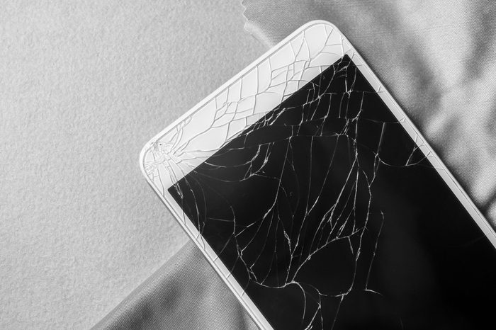 Broken mobile phone screen, close-up, black and white frame