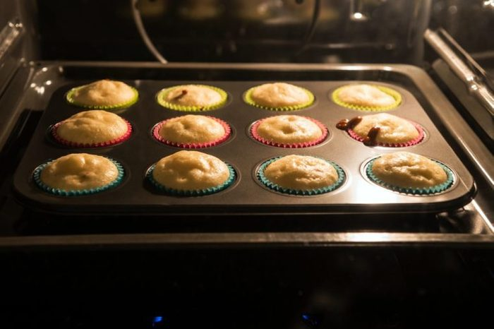 Baking muffins in the oven. Horizontal image.