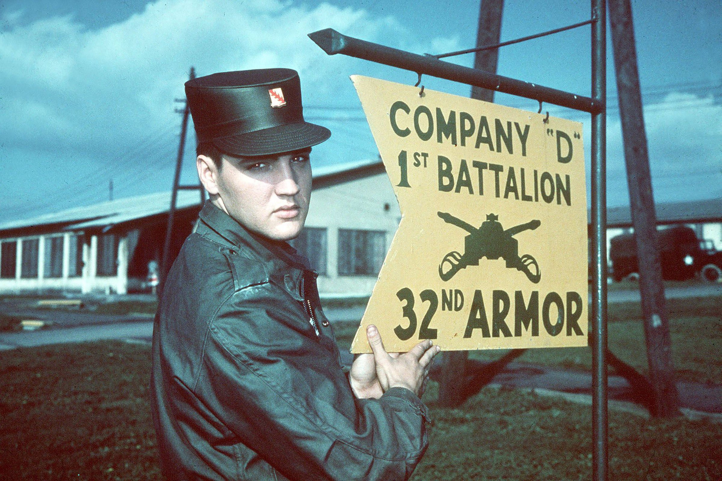 "Mandatory Credit: Photo by AP/Shutterstock (7395468a) ELVIS PRESLEY: ... the ""Pelvis"", in Army uniform at Company ""D"" 1st Battalion 32nd Armor, barracks area, Friedberg, West Germany. Undated picture Elvis Presley, FRIEDBERG, Germany"