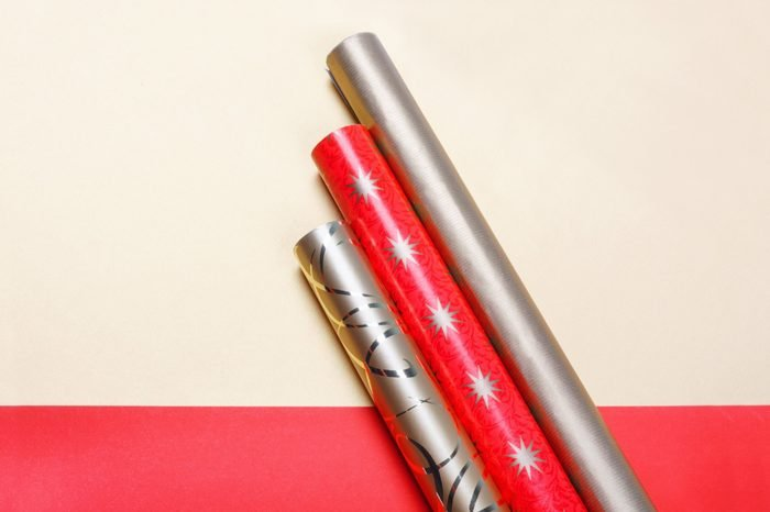Golden and red wrapping paper on bright background.Top view flat lay group objects