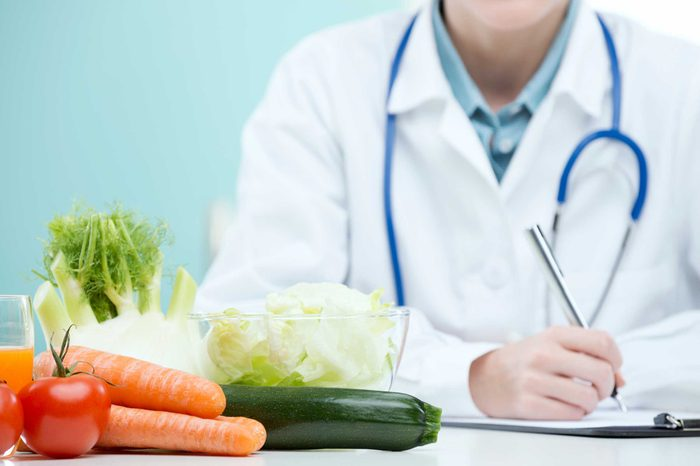 Doctor writing prescription for healthy diet