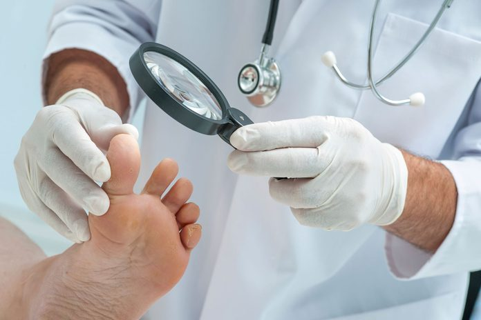 doctor examining a patient's foot