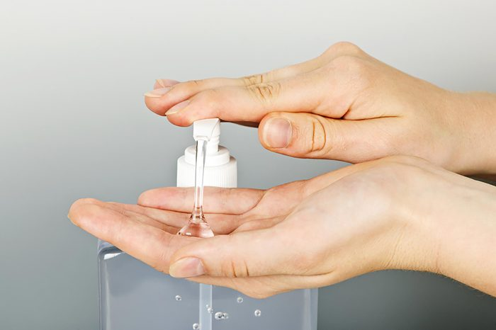 hands pumping sanitizer