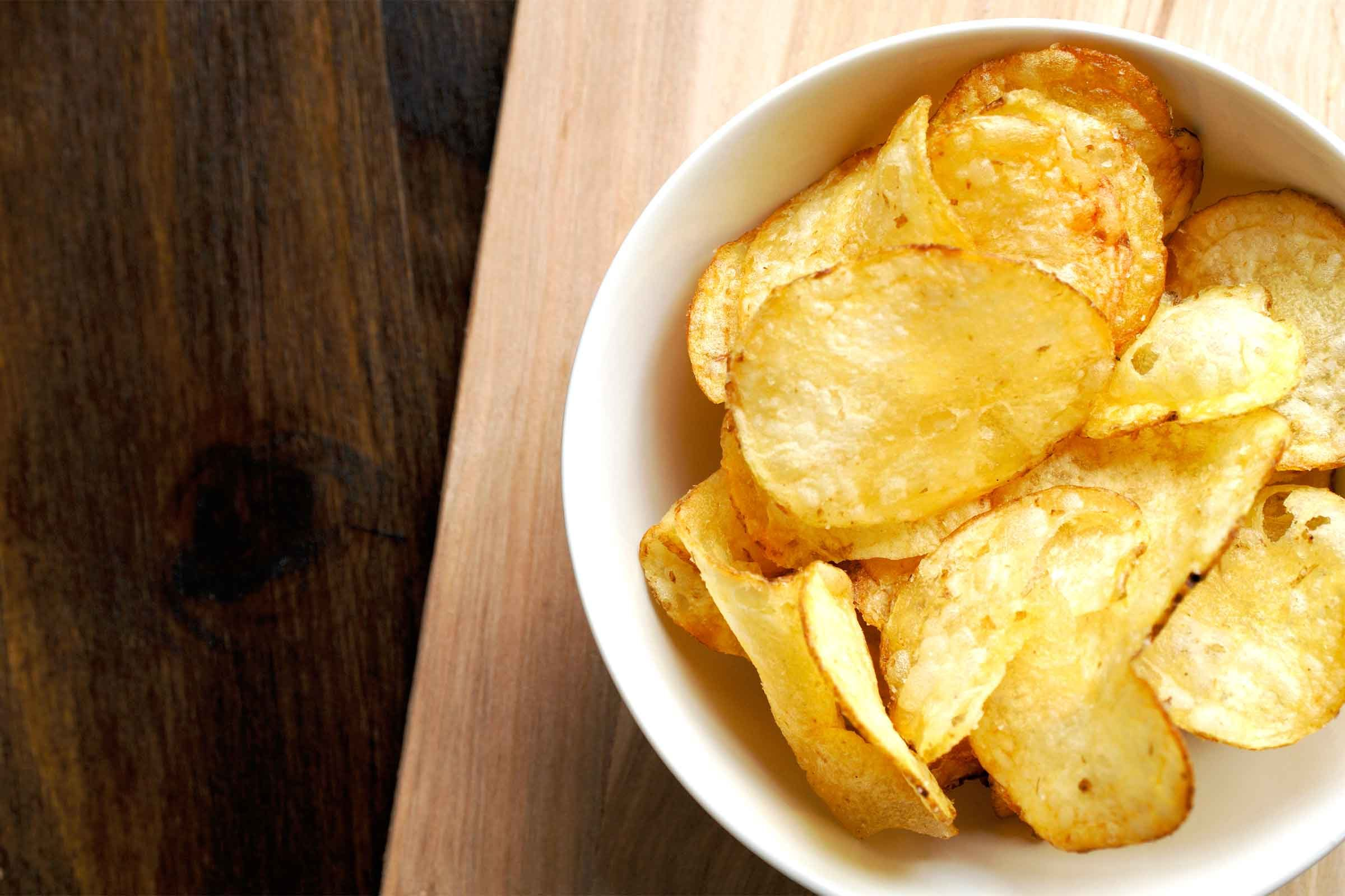 Potato chips in white bowl