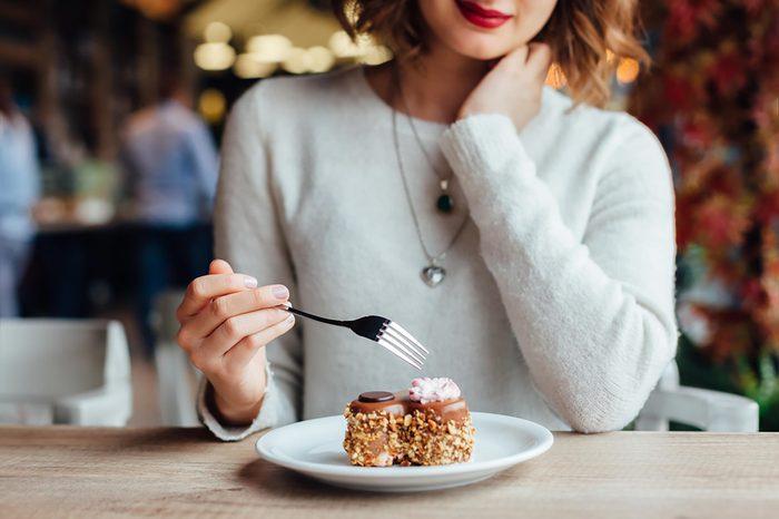 woman at a restaurant eating dessert